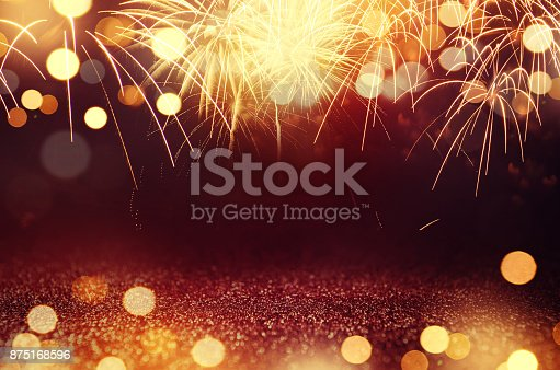 istock Fireworks and bokeh in New Year eve and space for text. Abstract background holiday. 875168596