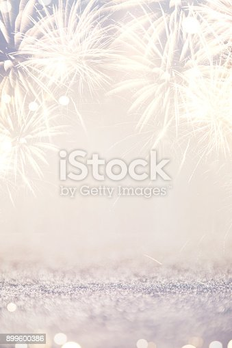 977840698 istock photo Fireworks and bokeh in New Year eve and space for text. Abstract background holiday. 899600386