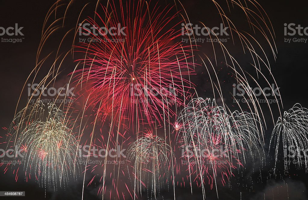 Fireworks and bright red colors dancing in the sky royalty-free stock photo