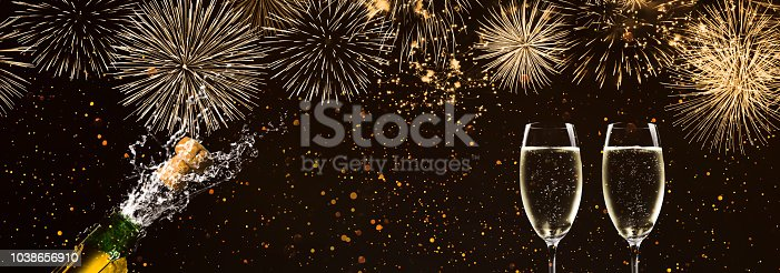 1051699126 istock photo fireworks and champagne glasses on festive background 1038656910
