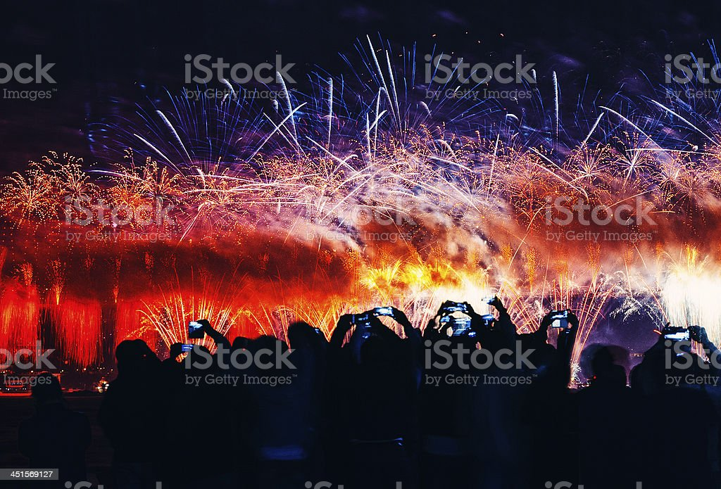 Fireworks and crowd stock photo