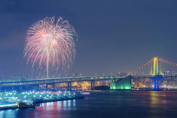 Fireworks and Rainbow Bridge in Tokyo at Night stock photo