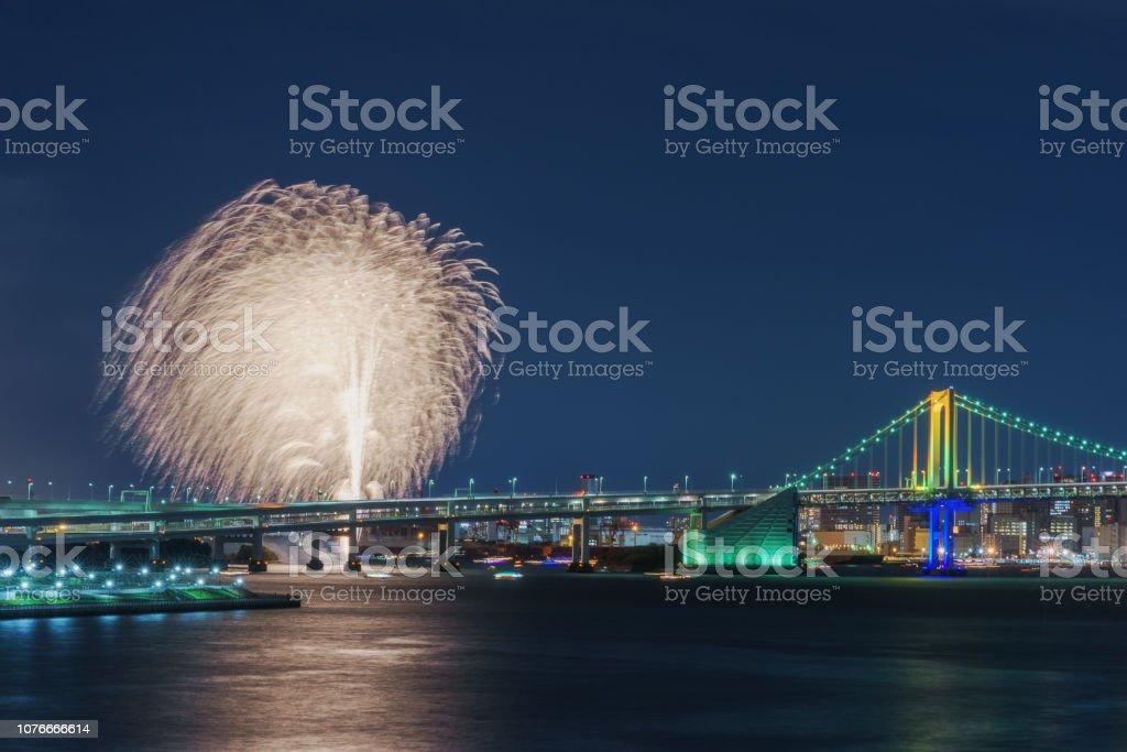 Fireworks and Rainbow Bridge inTokyo at Night stock photo