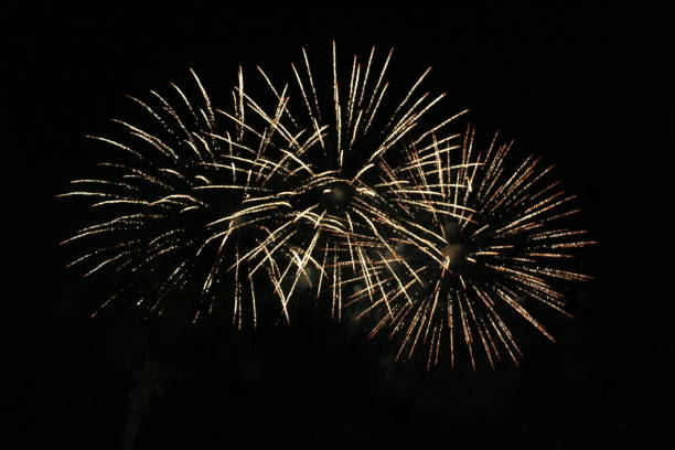 fireworks at new year's evening - firework display stock pictures, royalty-free photos & images