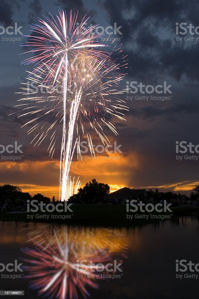 Fireworks at Sunset Reflected in Lake royalty-free stock photo
