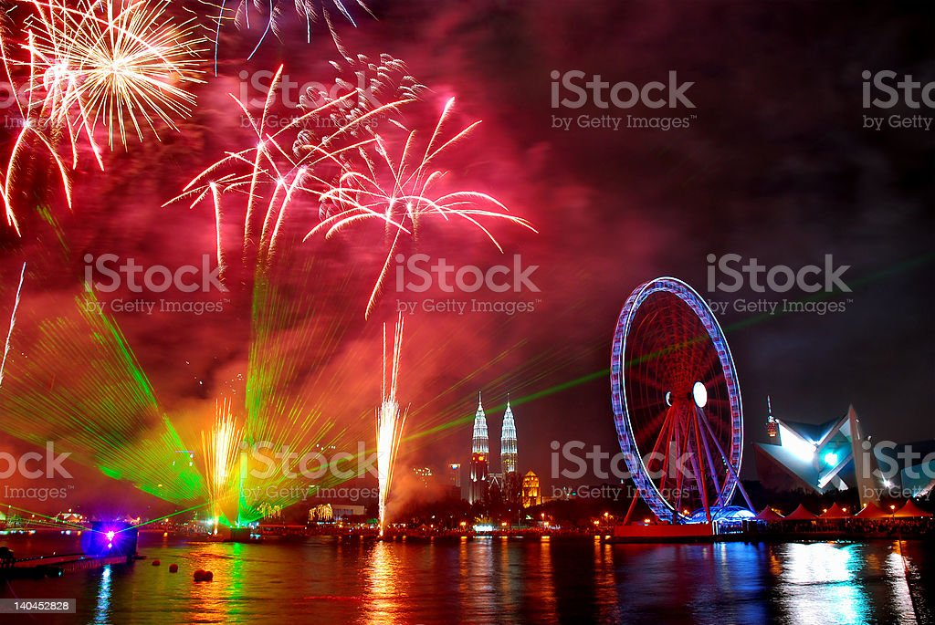 Fireworks at the ferris wheel royalty-free stock photo