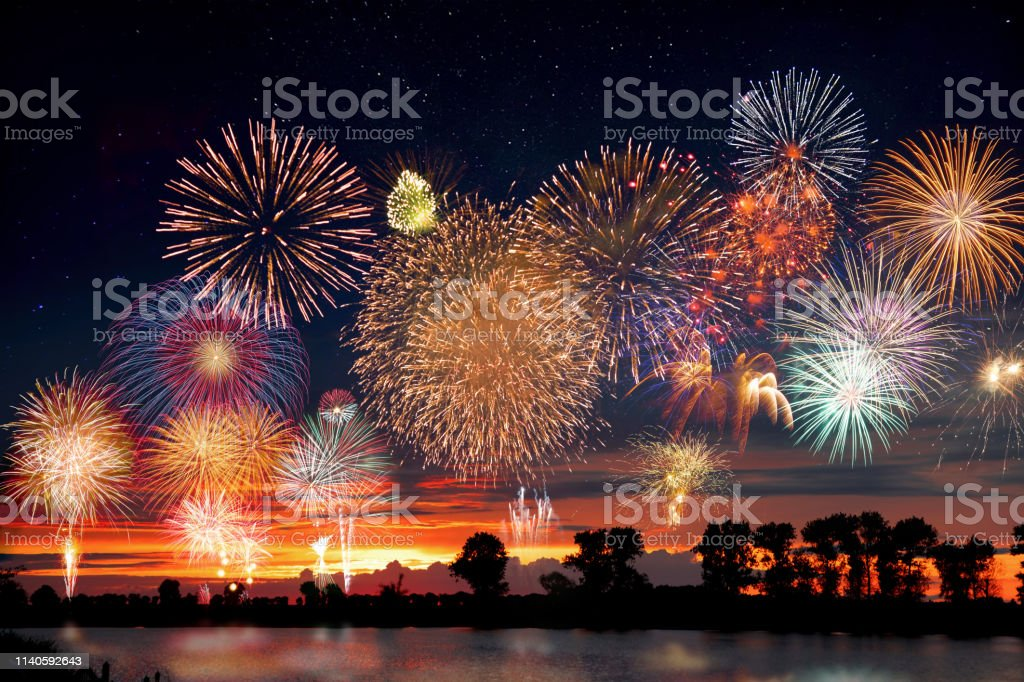 Fireworks at the lake during party event or wedding reception Fireworks at the lake during party event or wedding reception Above Stock Photo