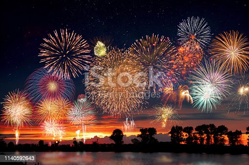 istock Fireworks at the lake during party event or wedding reception 1140592643