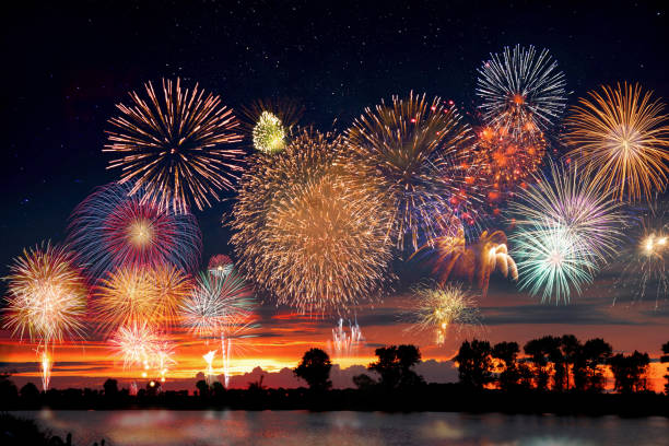 fireworks at the lake during party event or wedding reception - fireworks stock pictures, royalty-free photos & images