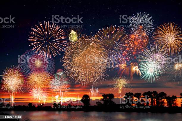 Photo of Fireworks at the lake during party event or wedding reception