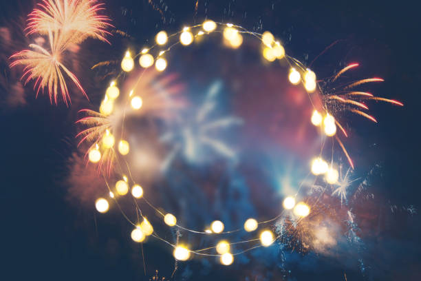 Fireworks background with empty lights garland for your text stock photo