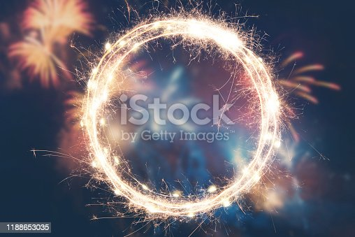 istock Fireworks background with empty sparkler frame for your text 1188653035