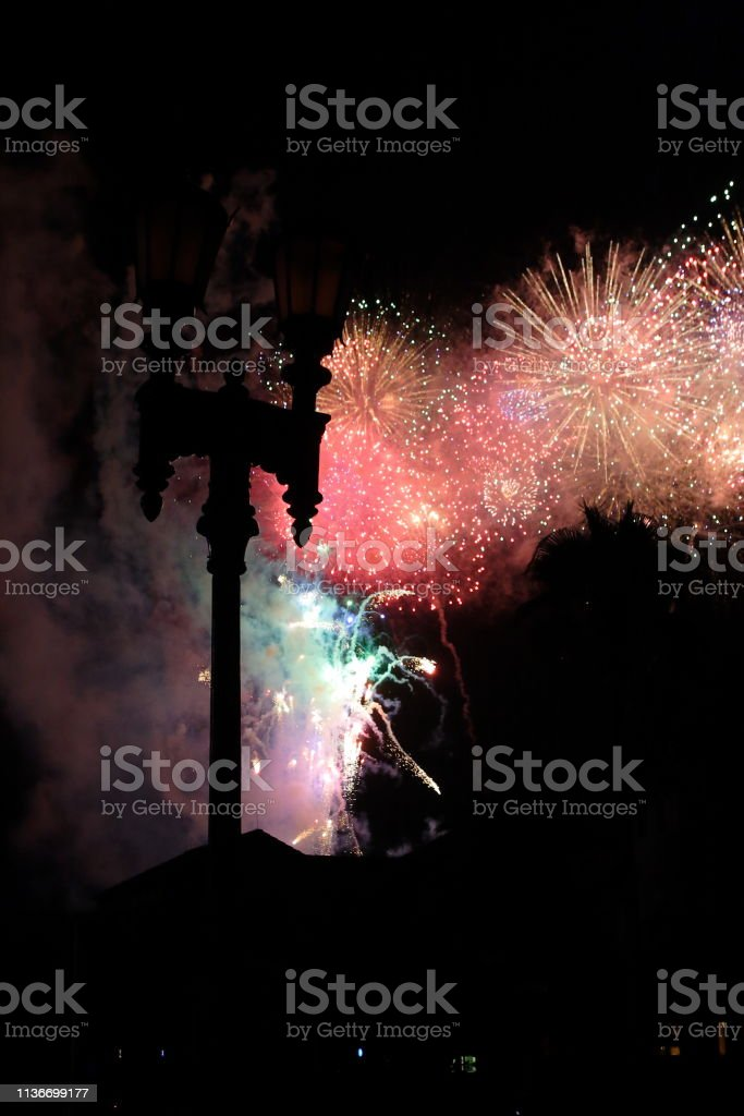 Fireworks behind an old street lamp stock photo