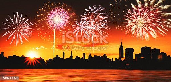 525385459 istock photo fireworks behind the new york city skyline 543211328