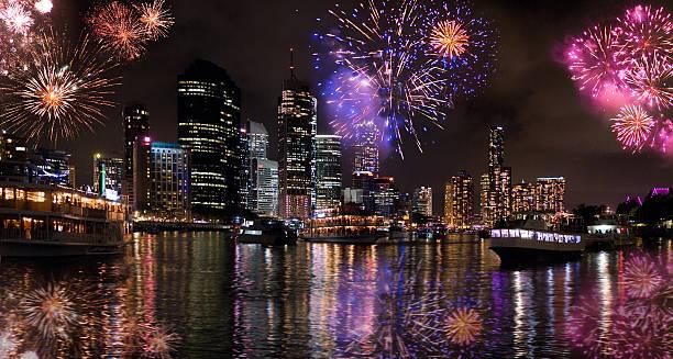 Fireworks bursting over city skyline during Riverfire Festival stock photo