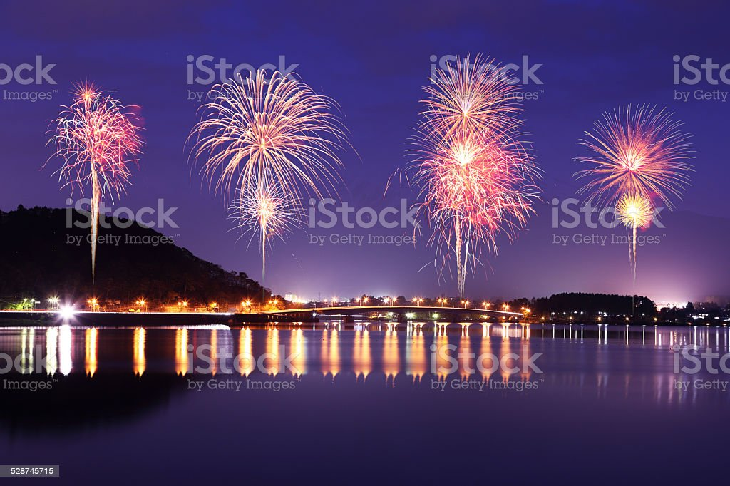 Fireworks celebrating over Lake Kawaguchiko at night with mount stock photo