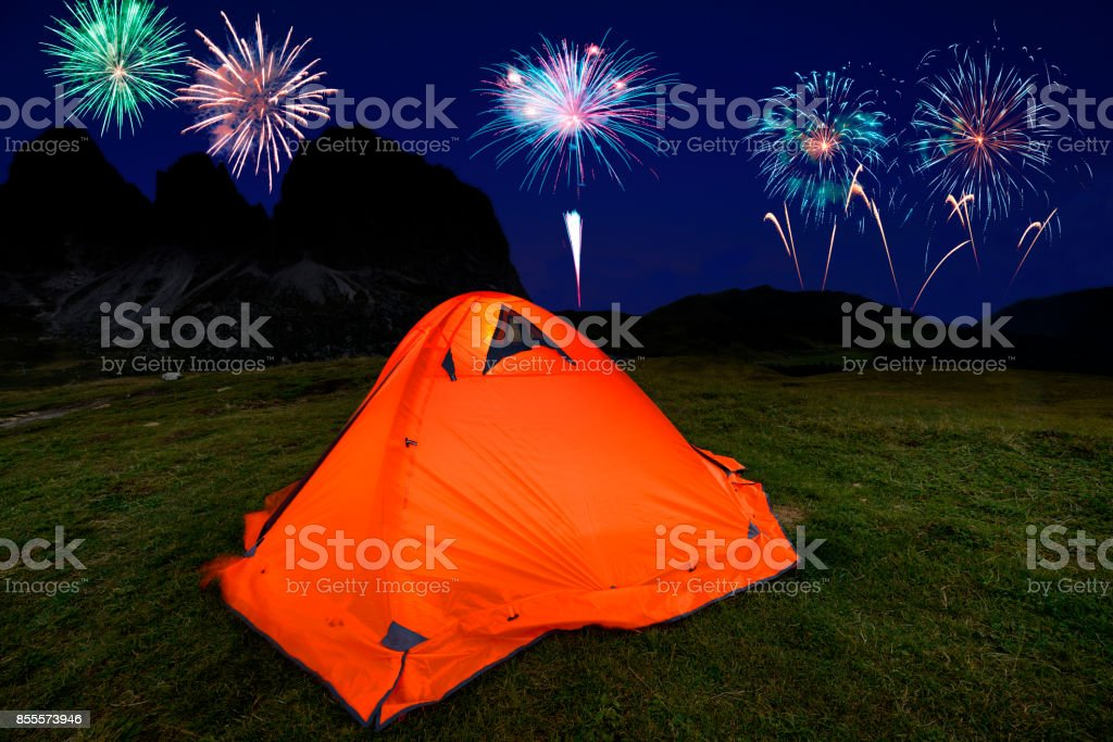 Fireworks celebration over Dolomites Mountain stock photo