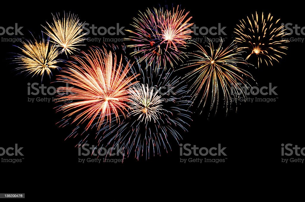 A fireworks display against the night sky Fireworks cluster. Backgrounds Stock Photo
