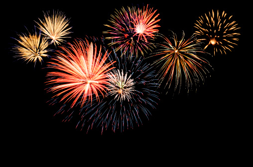 A Fireworks Display Against The Night Sky Stock Photo - Download Image Now