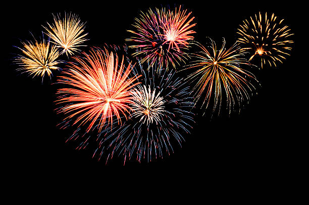 a fireworks display against the night sky - firework display stock pictures, royalty-free photos & images