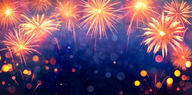 Fireworks Display Celebration - 2020 Trendy Phantom blue And Lush Lava Colors stock photo