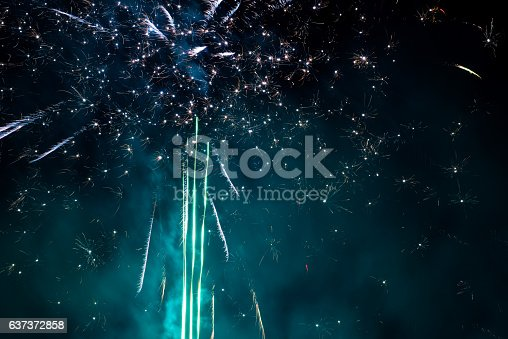 istock Fireworks display on dark sky background 637372858
