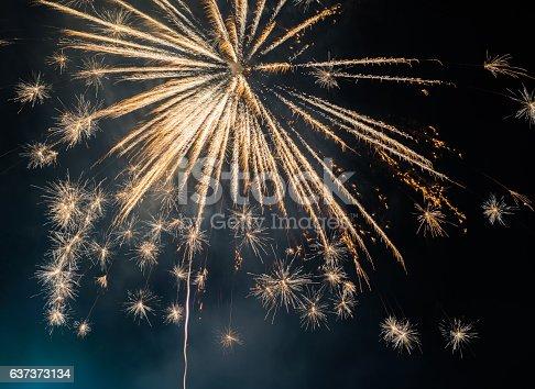 istock Fireworks display on dark sky background 637373134
