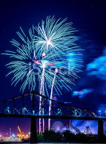 istock Fireworks display over a bridge 1050490206