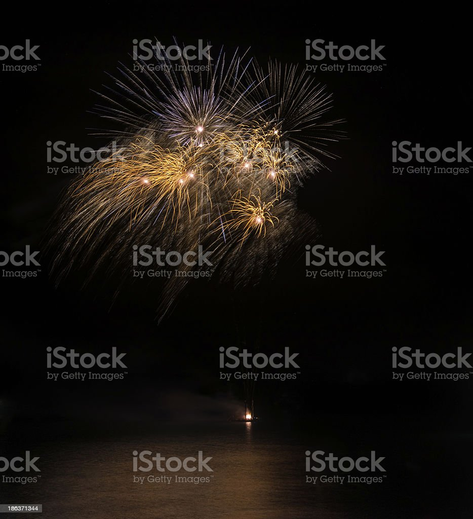 Fireworks display over sea with reflections in water royalty-free stock photo