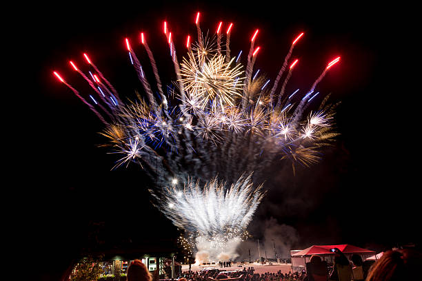 Fireworks explode at July 4th celebrations stock photo