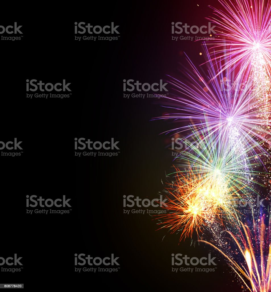 Fireworks explosions on black background Fireworks explosions isolated on black background. Free space for text. Celebration and success concept. Very high resolution image Black Color Stock Photo