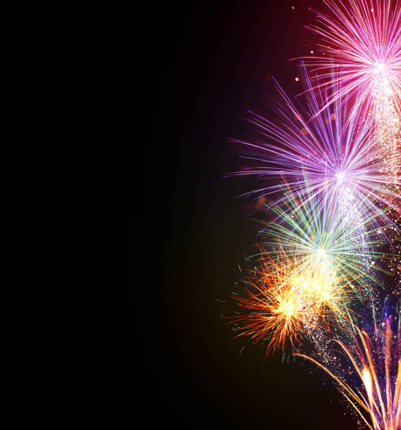 fireworks explosions on black background - fireworks stock pictures, royalty-free photos & images