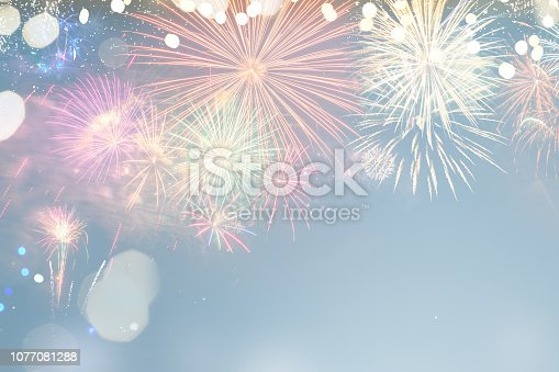 Fireworks colorful explosions on blue, festive background with copy space