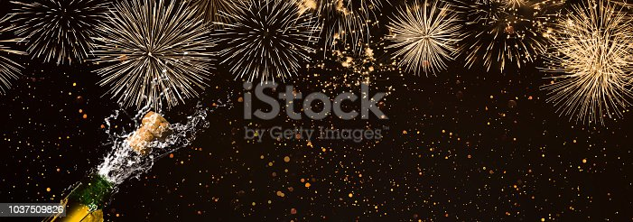 1051699126 istock photo fireworks fizzing champagne party night 1037509826