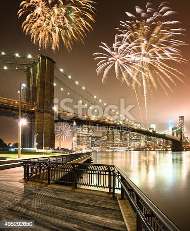 525385459 istock photo fireworks for a national holiday over the brooklyn bridge 495292650