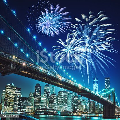 525385459 istock photo fireworks for a national holiday over the brooklyn bridge 541969238