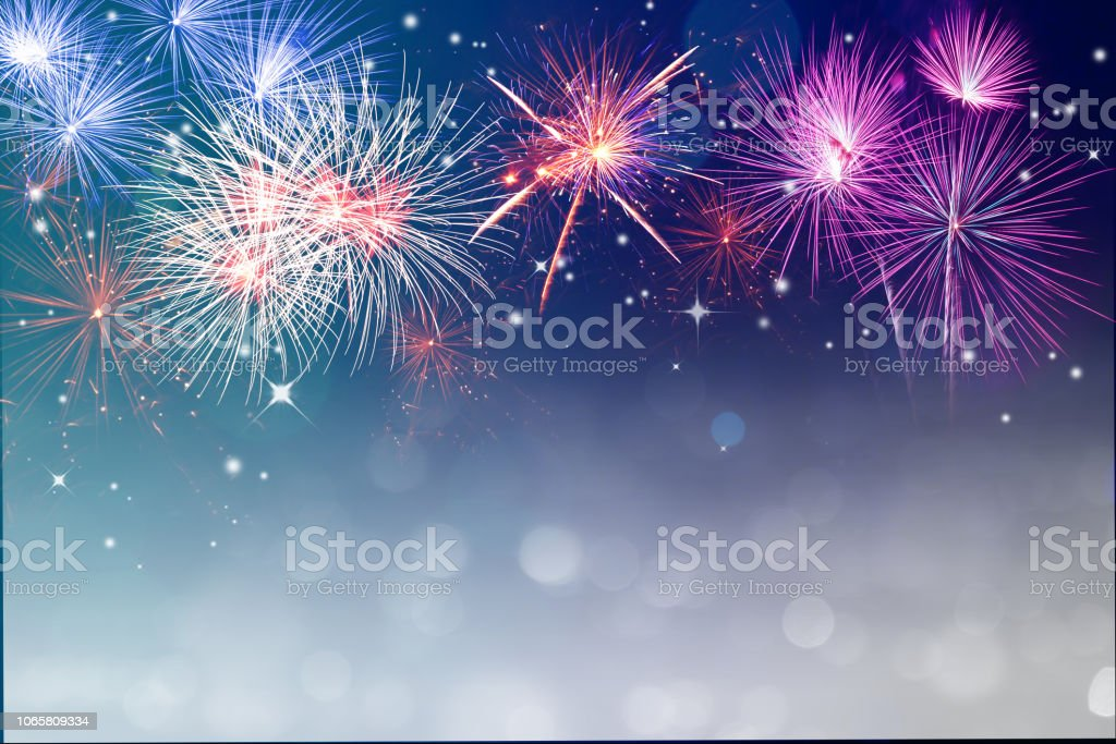 Fireworks for copyspace and background Abstract fireworks celebration on silver bokeh festive light background. Fireworks for copy space and background Backgrounds Stock Photo