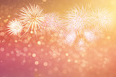 Abstract fireworks celebration on bokeh background.Fireworks for copyspace and background