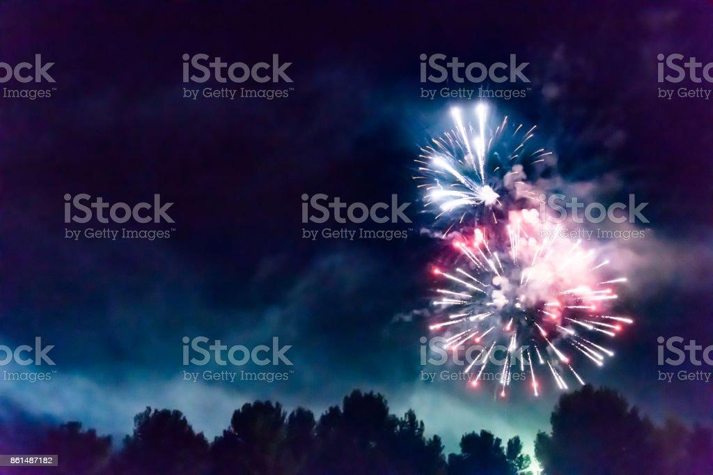 Fireworks in dark night sky stock photo