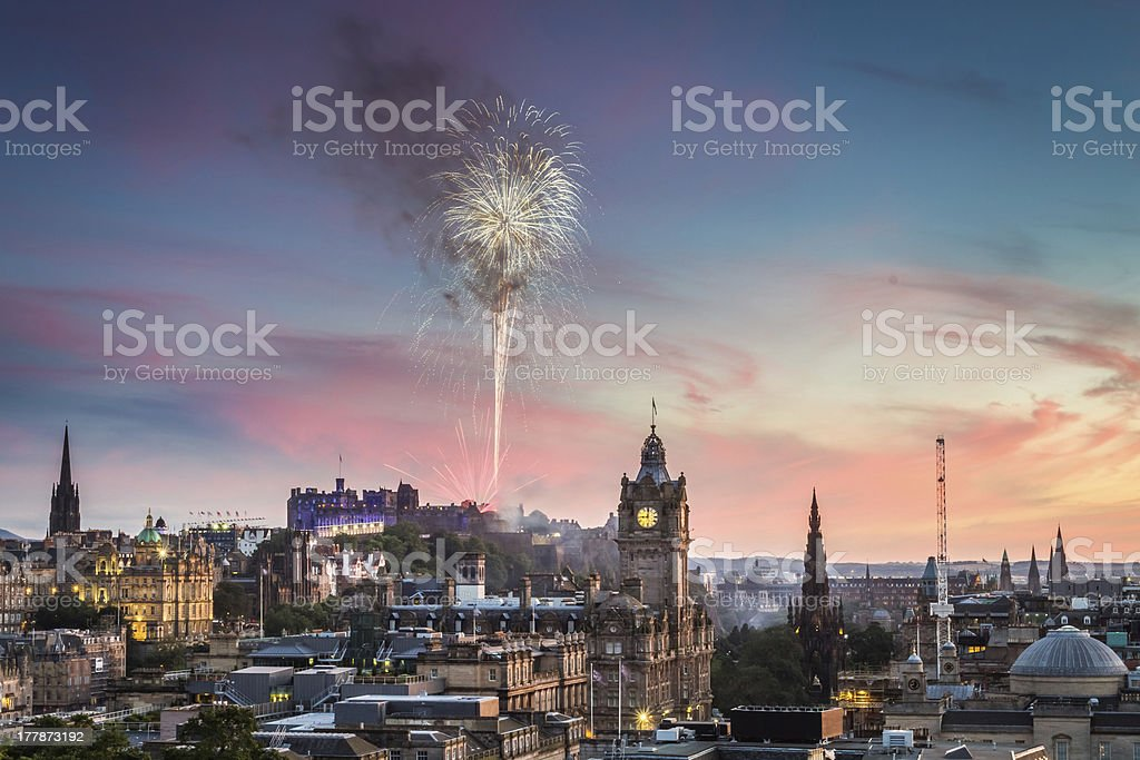 Fireworks in Edinburgh Castle at sunset royalty-free stock photo
