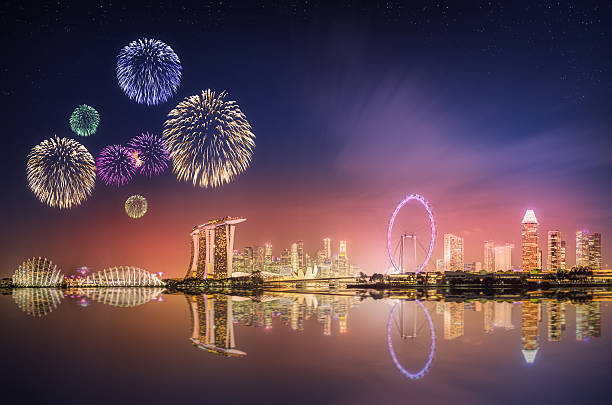 Fireworks in Marina Bay, Singapore Skyline Beautiful fireworks in Marina Bay and view of skyscrapers on Singapore merlion fictional character stock pictures, royalty-free photos & images