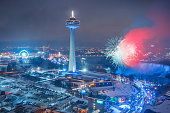 Stock photograph of fireworks in Niagara Falls Ontario Canada during winter time.