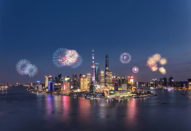 Fireworks in Shanghai with Shanghai cityscape Fireworks in Shanghai with Shanghai cityscape huangpu river stock pictures, royalty-free photos & images
