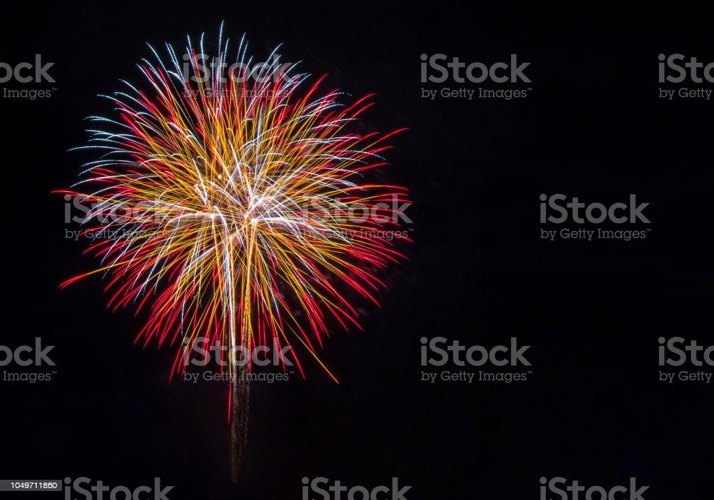 fireworks in the dark sky background stock photo