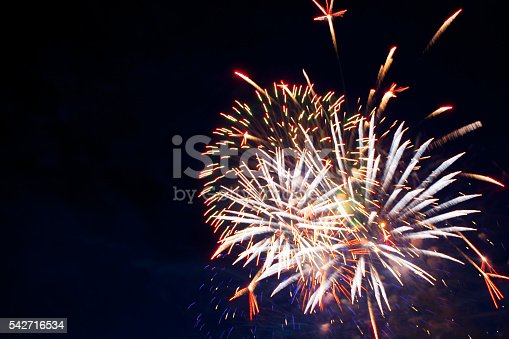 542714484 istock photo Fireworks in the evening sky with majestic clouds, long exposure 542716534