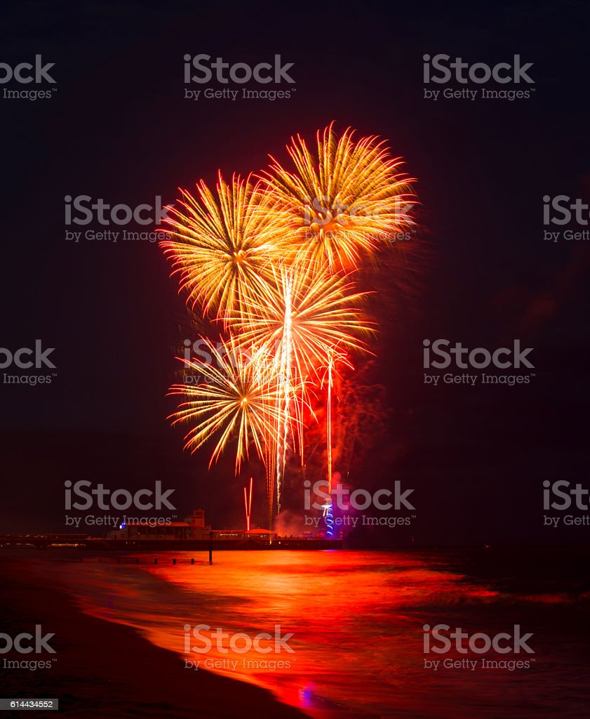 Fireworks in the sky reflected in seas at Bournemouth Pier stock photo