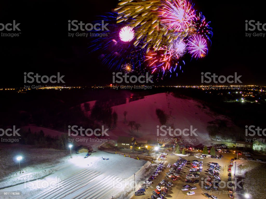 Fireworks launch at Great Bear Ski Hill in Sioux Falls, South Dakota for New Years Eve stock photo