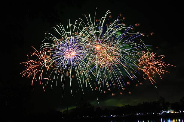 Fireworks light up the sky. stock photo