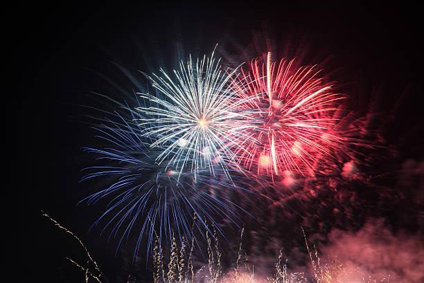 Fireworks light up the sky wit smoke. Colorful. stock photo