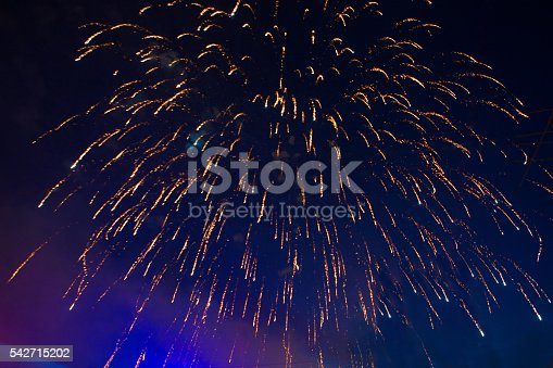 542714484 istock photo Fireworks of various colors bursting against a black 542715202
